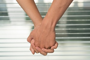 couple-holding-hands-outside-office